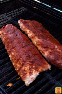 Baby back ribs cooking on the grill