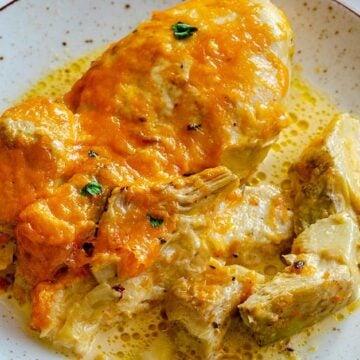 Chicken artichoke casserole on a white plate