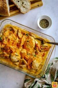 Baked chicken artichoke casserole in glass dish