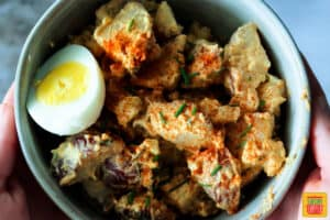 Fully mixed Spanish potato salad in a bowl