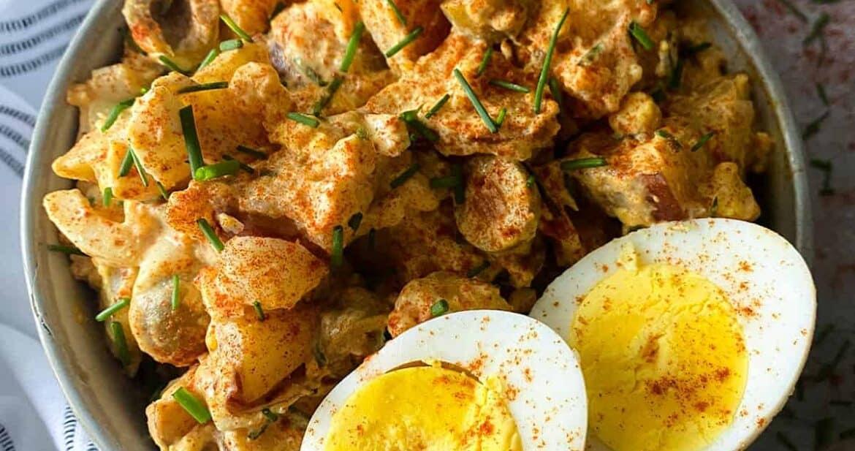 Spanish potato salad with two hard-boiled egg halves on a bowl