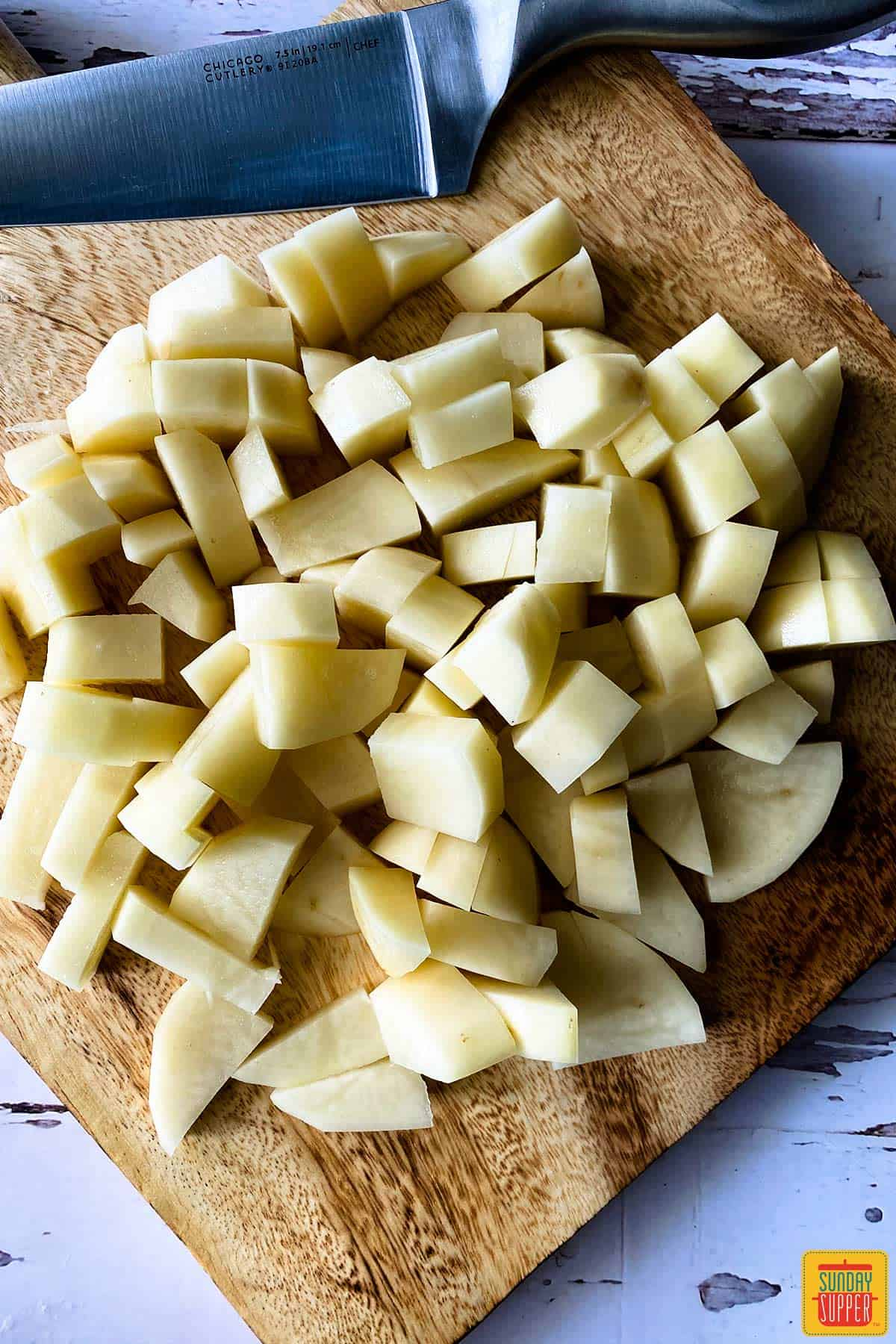 russet potatoes diced on a cutting board