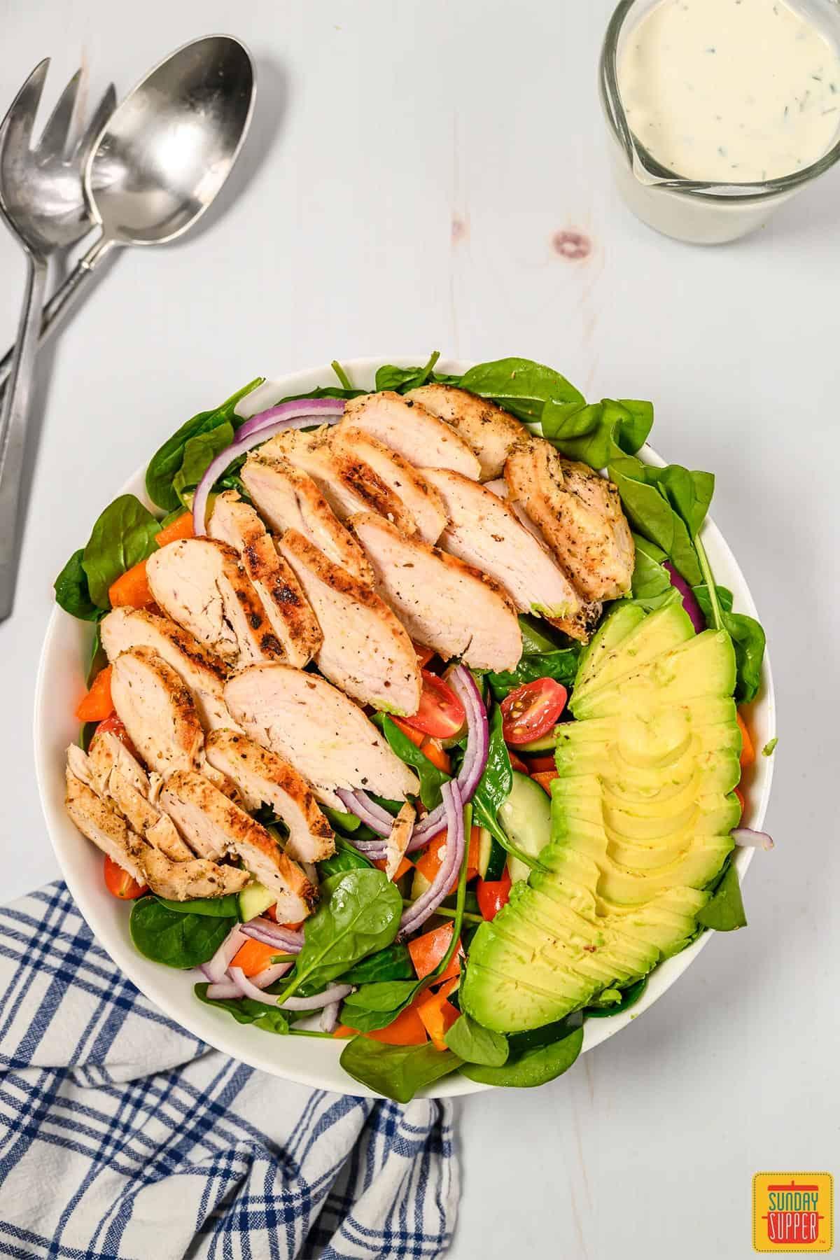 Sliced chicken on grilled chicken salad