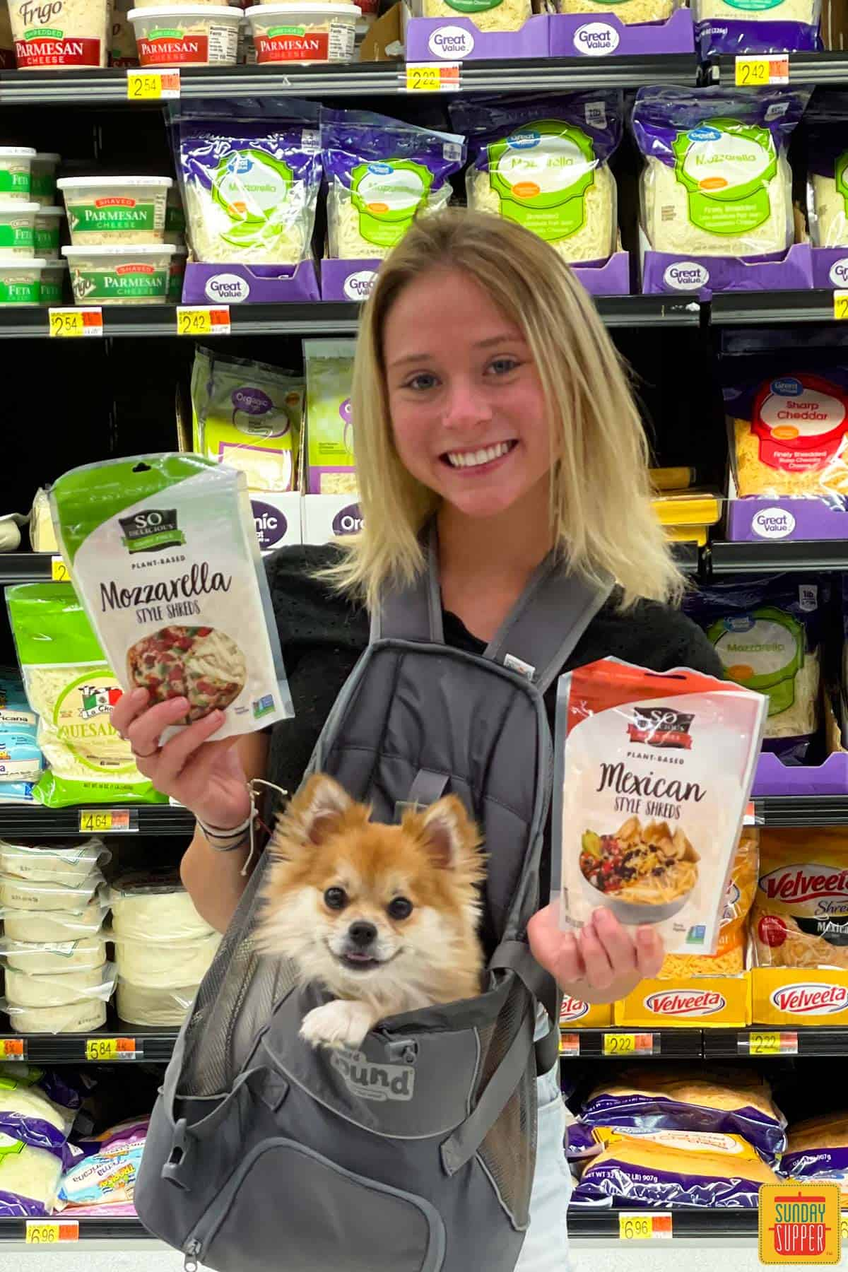 Izzy at Walmart with her dog holding two bags of Plant-based shreds by So Delicious