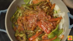 Adding salsa to quesadilla filling