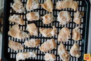 Chicken bites on air fryer tray