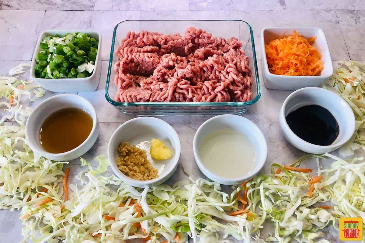 Ingredients to make egg roll in a bowl on a countertop