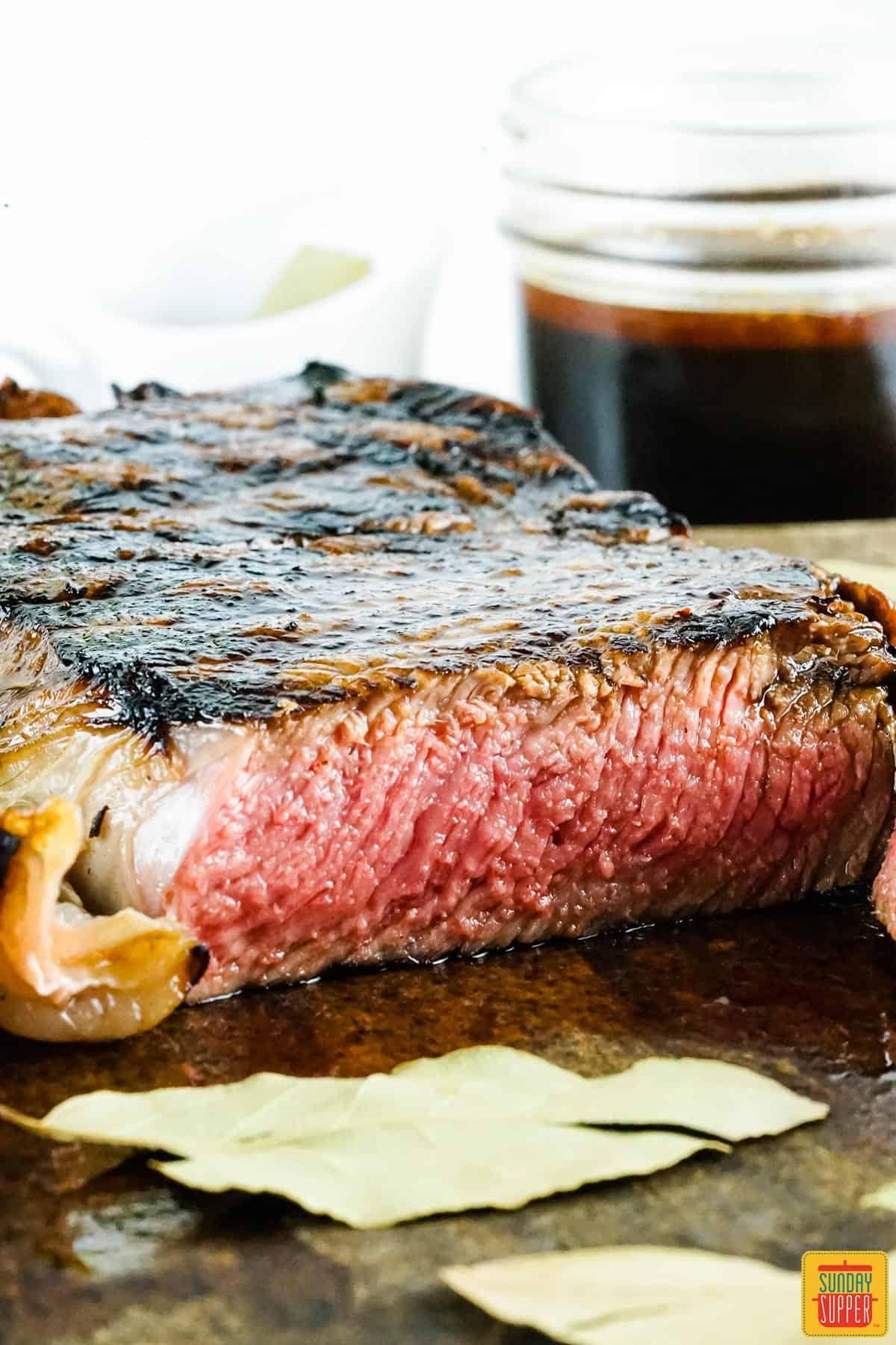 Grilled steak sliced on a cutting board
