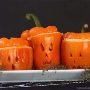 Stuffed peppers that look like jack-o-lanterns