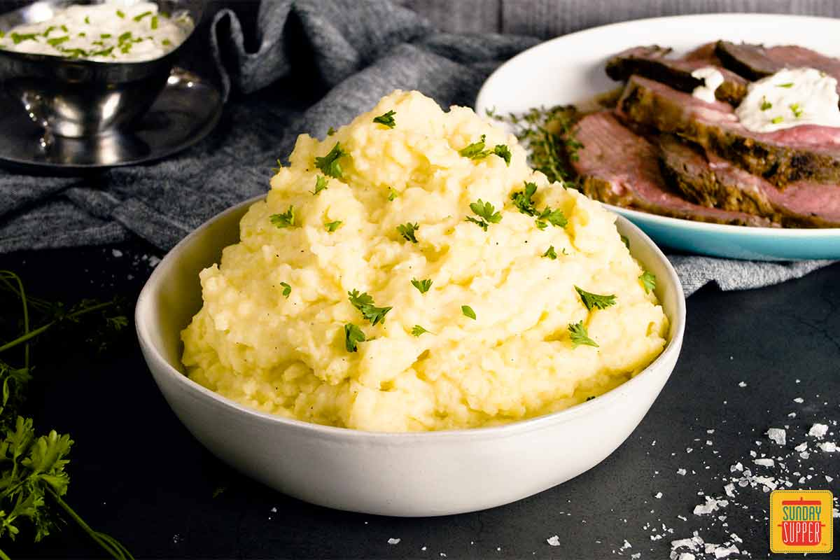 creamy mashed potatoes piled high in a white dish